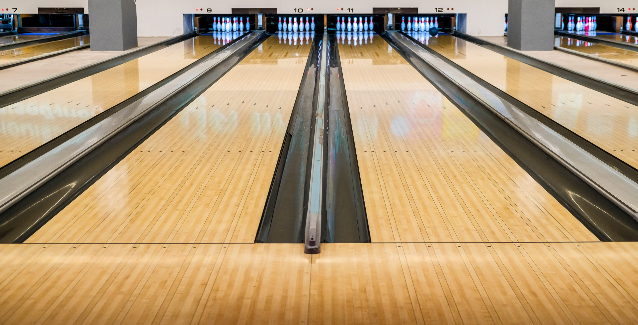 Bowling wooden floor with lane, Generic Bowling Alley lanes with bowling ball going towards the pins.