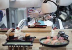 Smart robot preparing japanese food a dish of sushi