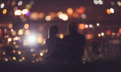 Romantic Lovers couple against background night city, sky star. Concept romance date Valentine Day, first kiss love