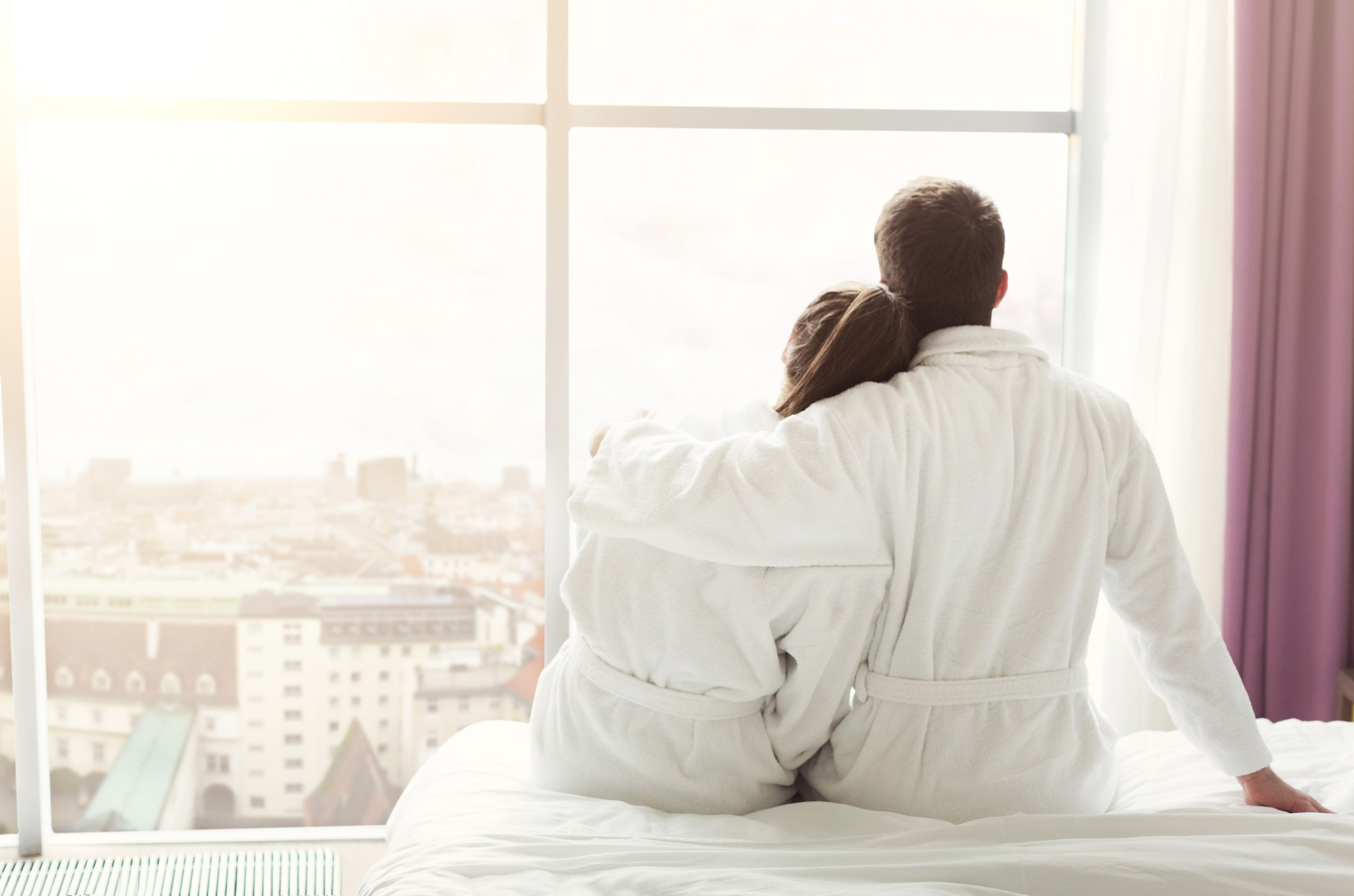 Morning of happy young couple resting in hotel room