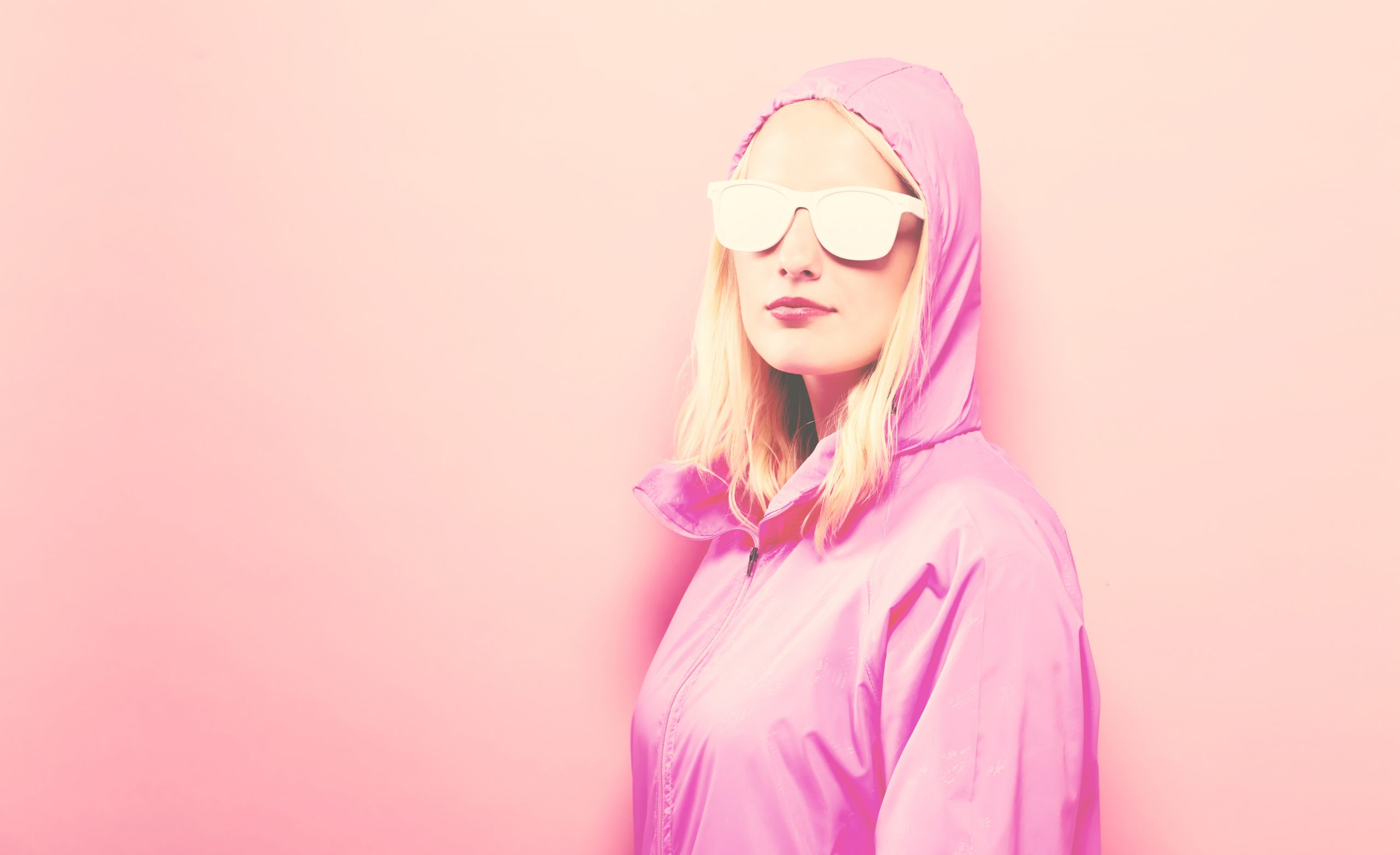 Fashionable woman in raincoat and sunglasses