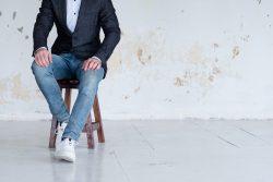 man jacket jeans sit confident business trainer