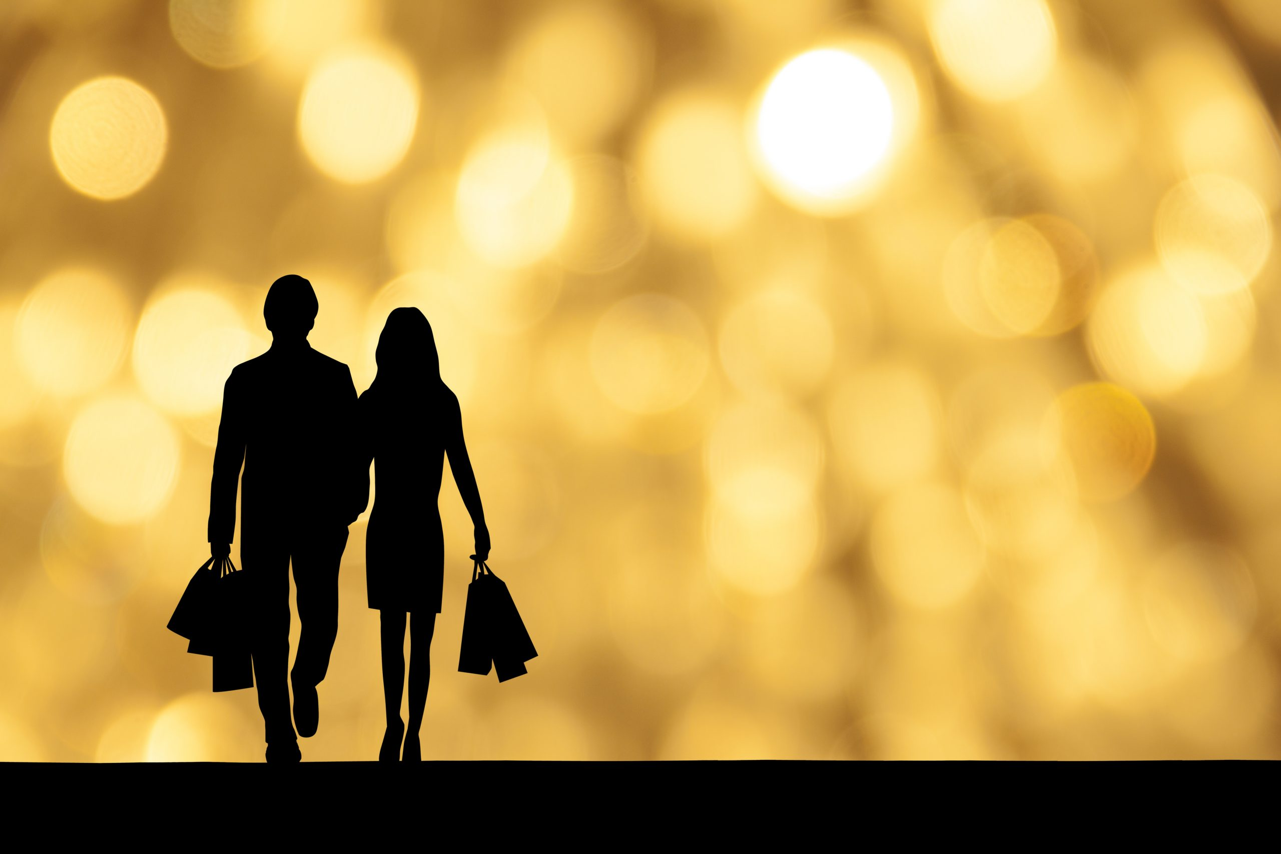 Happy young couple walking on city street and neon background